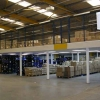 raised level mezzanine over warehouse stock